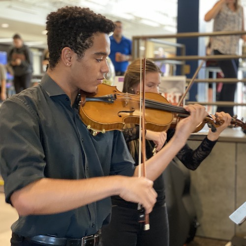 Spotlight story image pertaining to student playing violin